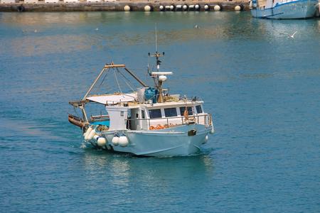 dyllic: Small boat in the waters of the Tyrrhenian Sea, Elba Island, Tuscany, Italy Stock Photo