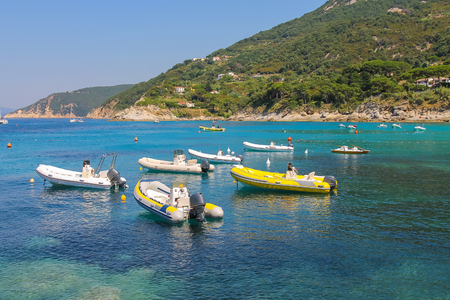 tyrrhenian: Anchored motorboats in waters of Tyrrhenian Sea, Sant Andreas on Elba Island, Italy