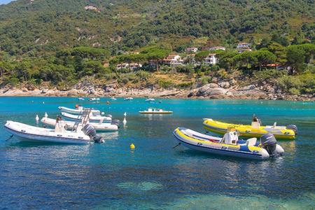 tyrrhenian: St Andreas, Italy - July 01, 2015: Anchored motorboats in waters of Tyrrhenian Sea, Sant Andreas on Elba Island, Italy Editorial