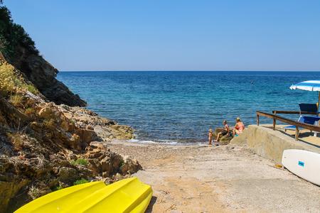 tyrrhenian: Elba Island, Italy - June 30, 2015: People taking a sunbath on the coast of the Tyrrhenian Sea on Elba Island.