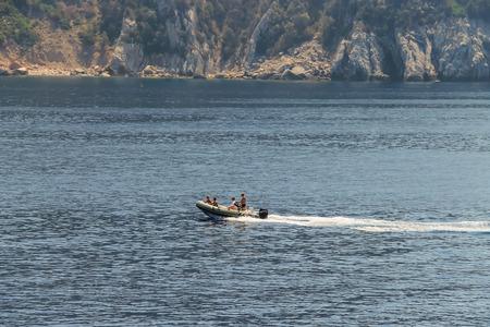 tyrrhenian: Elba Island, Italy - June 30, 2015: People sailing on motorboat in waters of Tyrrhenian Sea, region of Tuscany