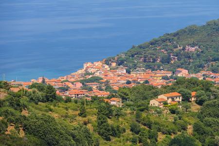 tyrrhenian: Coast of Tyrrhenian Sea on Elba Island, Italy. Panorama of Marciana Marina. View from Marciana. Stock Photo