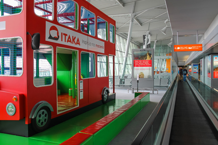 warsaw chopin: Warsaw, Poland - Apr 18, 2015: Kids playground-bus in Warsaw Chopin Airport. WAW is the largest and busiest airport in Poland. It hosts more than 8 million passengers each year