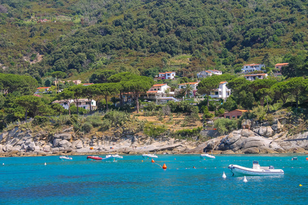 motorboats: St Andreas, Italy - July 01, 2015: Anchored motorboats in waters of Tyrrhenian Sea, Sant Andreas on Elba Island, Italy Editorial