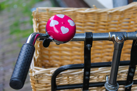 handlebars: Pink bicycle bell with white hearts on handlebars Stock Photo