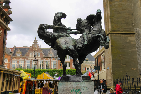 jousting: Haarlem, the Netherlands - June 20, 2015: Statue of two jousting knights on horses on the Grote Markt in in the historic center of town. Haarlem is the popular holland tourist place