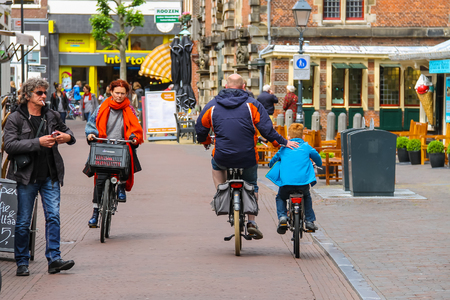 urban people: Haarlem, the Netherlands - June 20, 2015: People in the historic center of town. Haarlem is the popular holland tourist place