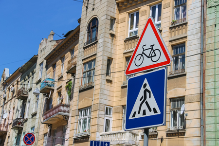 watch city: Traffic signs on the city street (Watch for cyclists and Pedestrian crossing), Lviv, Ukraine
