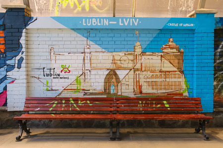 graffity: Lviv, Ukraine - July 5, 2014: Street art panel by graffiti artists from Poland on tram stop Rusalka Dnestrova in city centre. Works were made on the occasion of Europe Day in Lviv