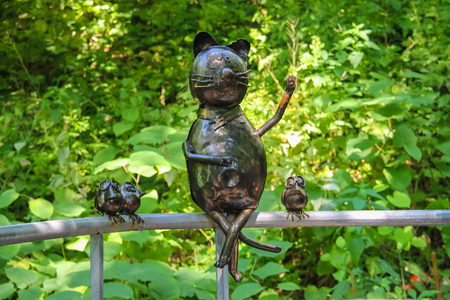 woodland sculpture: Lviv, Ukraine - July 5, 2014: Metal figures of funny cat and birds in Stryiskyi Park