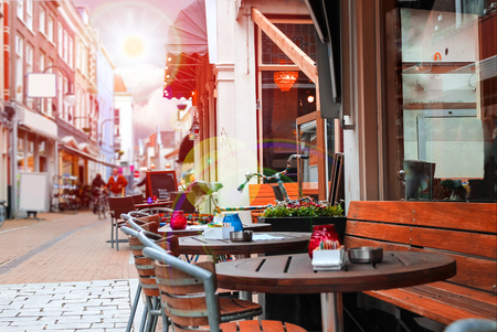 gorinchem: Urban street with a picturesque cafe in rays sun Stock Photo