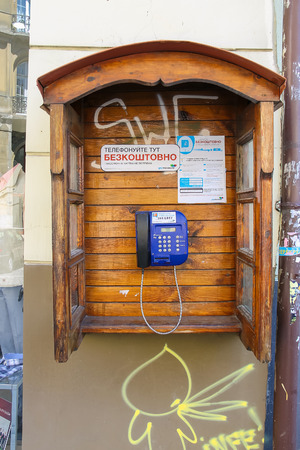 telephone booth: Lviv, Ukraine - July 5, 2014: Free city phone in a wooden telephone booth