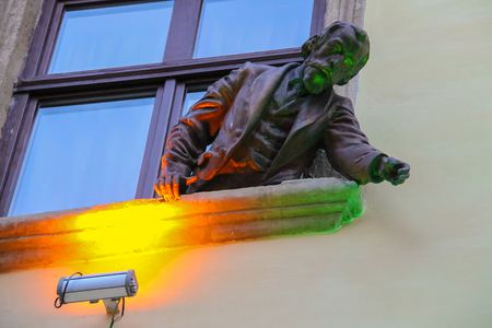 invented: Lviv, Ukraine - July 5, 2014: Sculpture of Ignacy Lukasiewicz from window of pub-museum Gas Lamp. Jan Zech and Ignacy Lukasiewicz invented gas lamp in 1853 Editorial