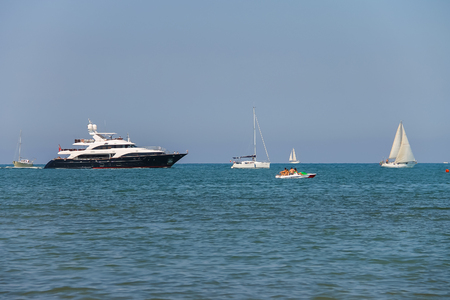 tyrrhenian: Viareggio, Italy - June 28, 2015: Sailing boats in Ligurian Sea. Viareggio is the famous resort and tourist centre of Tuscany region Editorial