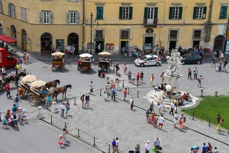 angels fountain: Pisa, Italy - June 29, 2015: Tourists near the fountain with angels on Piazza del Duomo. View from Leaning Tower