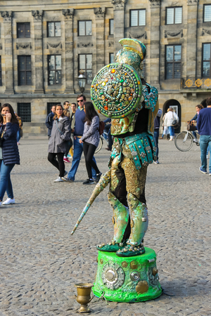 pretender: Amsterdam, the Netherlands -October 03, 2015: Human statue street performer on Dam Square in historic city centre