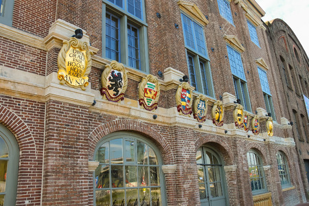 city coat of arms: Amsterdam, the Netherlands -October 03, 2015: Old building with coat of arms on facade in the historic city center. Editorial
