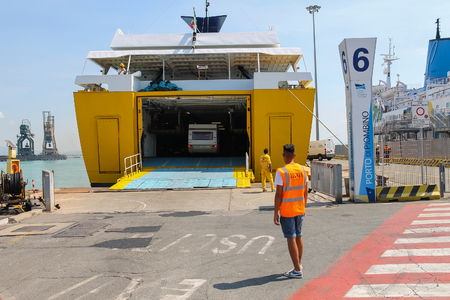 docker: Piombino, Italy - June 30, 2015: Ferry boat Corsica Express unloading vehicles from cargo hold Editorial