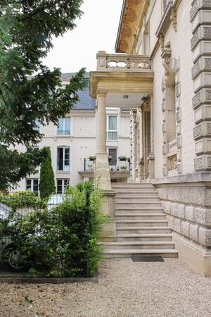 chantilly: Ancient building with marble stairs, balcony and porch in Chantilly, Oise, France