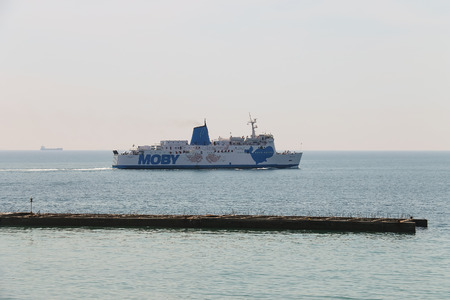 Piombino, Italy - June 30, 2015: Sailing ferry boat Moby Love in the seaport Editorial