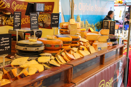 seller: Utrecht, the Netherlands - February 13, 2016: Shelves with famous Dutch cheese in the street market