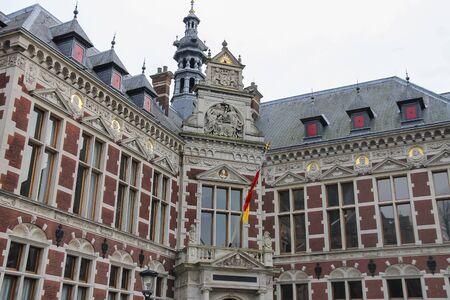 University Hall of Utrecht University and statue of Count (Graaf) Jan van Nassau in Dom Square, the Netherlands Stock Photo