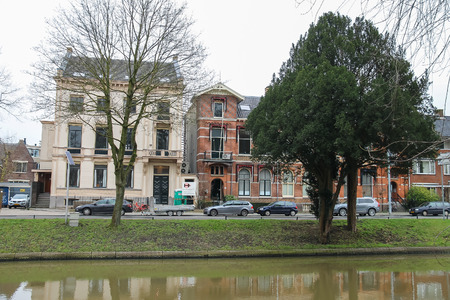 Utrecht, the Netherlands - February 13, 2016: Old buildings near canal in historic city centre