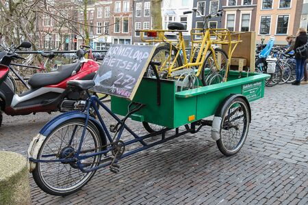 Utrecht, the Netherlands - February 13, 2016: Cargo bike with bikes on it in city centre (Oudegracht)