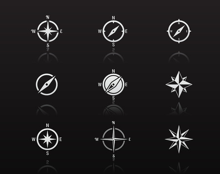 compass rose: Set of isolated white icons on a theme compass