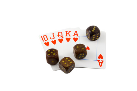 royal flush: wooden dices with royal flush poker cards isolated on white background