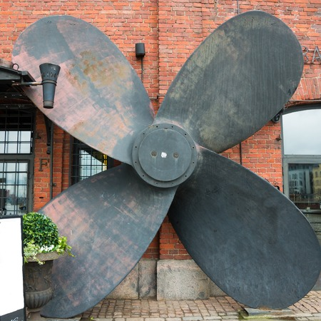 a large ship propeller on the wall decoration