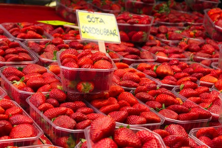Fresh ripe strawberry on a market counter at summer