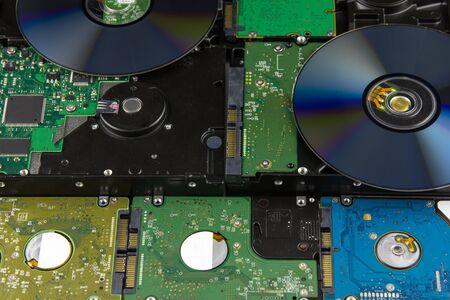 gigabyte: multiple hard disk drives lying close background