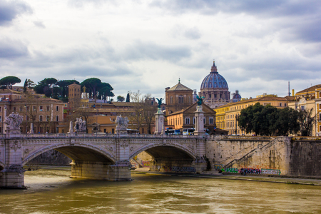 River Tiber in Rome - Italy. Including: Ponte Sant Angelo and St. Peters Basilica in the background.