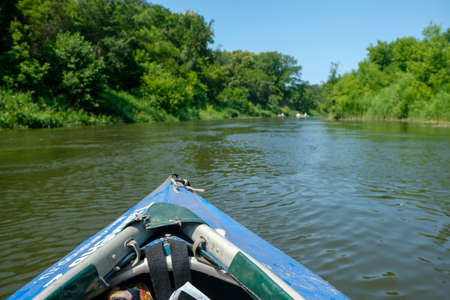 View from the blue kayak on the river banks