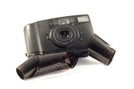 analogue: old film camera on white background