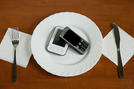 utensil with two mobile phone on the table