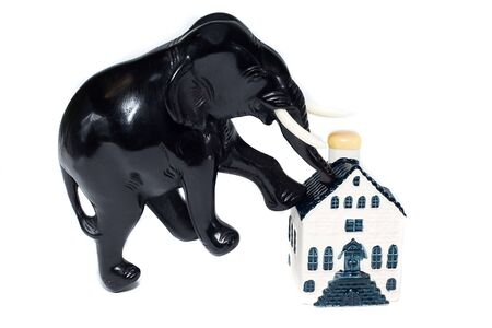isolaten: elephant step on house isolaten on white