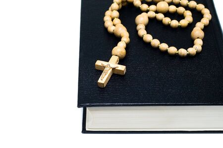 minister: Bible with cross isolated on white