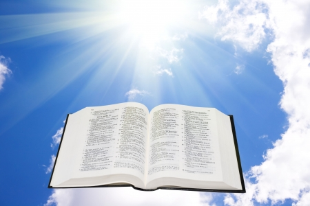 Holy bible in the sky illuminated by a sunlight 스톡 콘텐츠