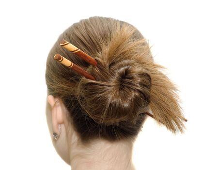 woman coiffure with asian sticks isolated on white photo