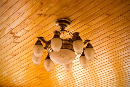 elegant chandelier on wooden ceiling photo