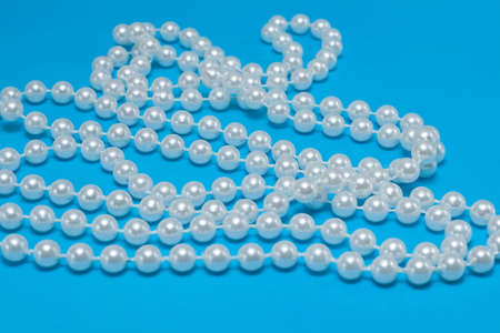 string of pearls on blue background photo