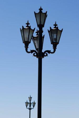 streetlamp over blue sky photo