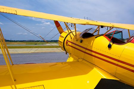 Yellow vintage plane on the ground