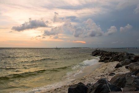 sunset on the rocky beach. destin, florida, usa photo