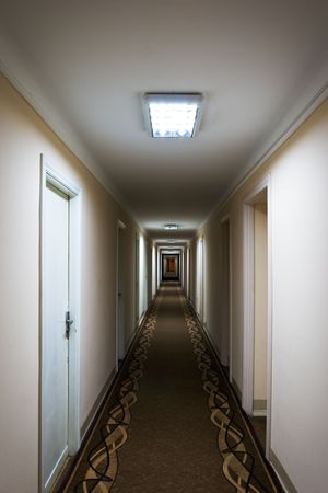 Long corridor of old grunge hotel  photo