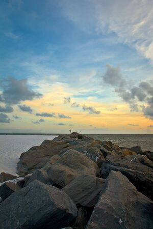 Mysterious view of stones in water after sunset Stock Photo - 5795331