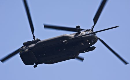 military chinook helicopter over blue sky photo