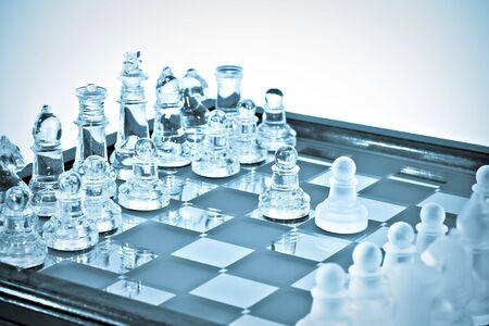 Transparent chess. blue toned photo